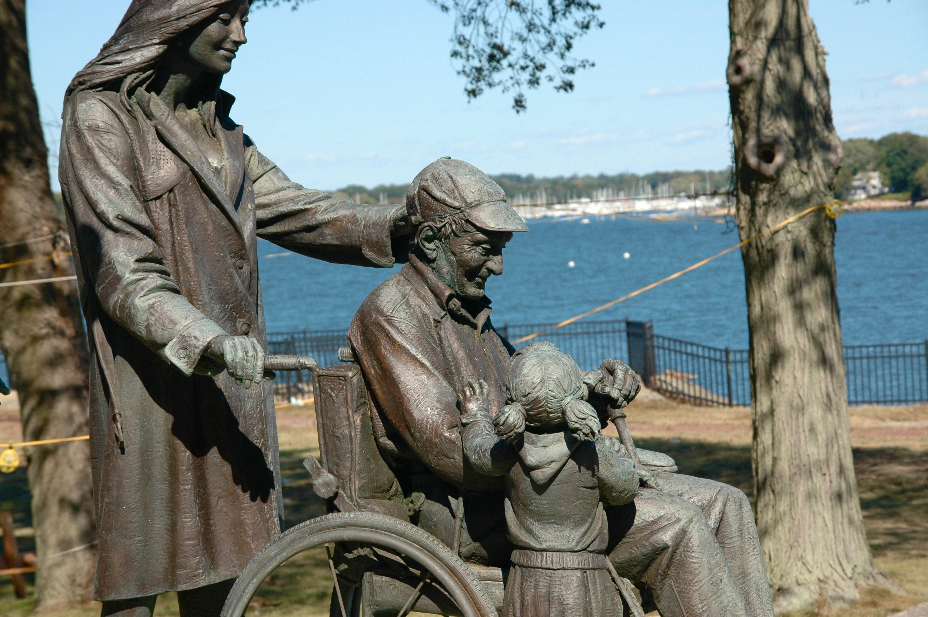 A statue outside Connecticut Hospice of an elderly man, surrounded by family and love.