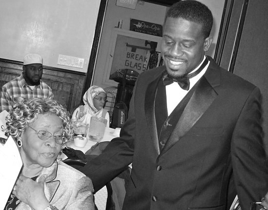Shafiq Abdussabur with his grandmother after being sworn in as president of the National Association of Black Law Enforcement Officers. Photo by Allan Appel.
