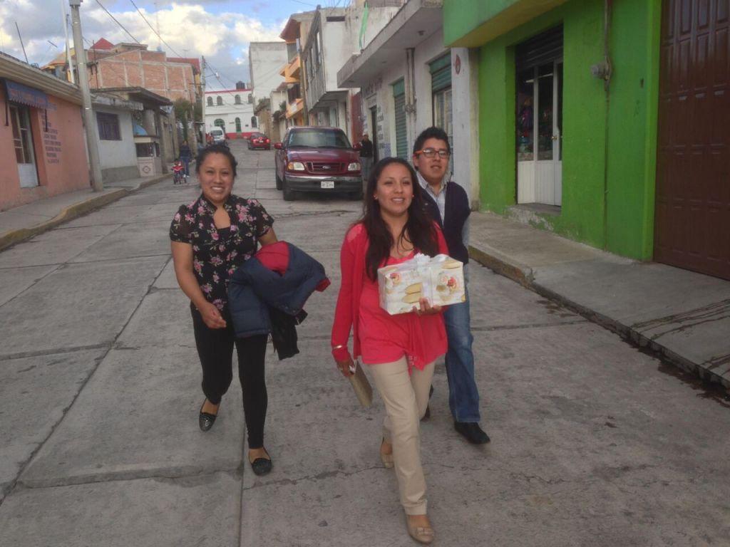 Jackie, Elena, and Aldo Mendieta walk to an aunt's birthday party.