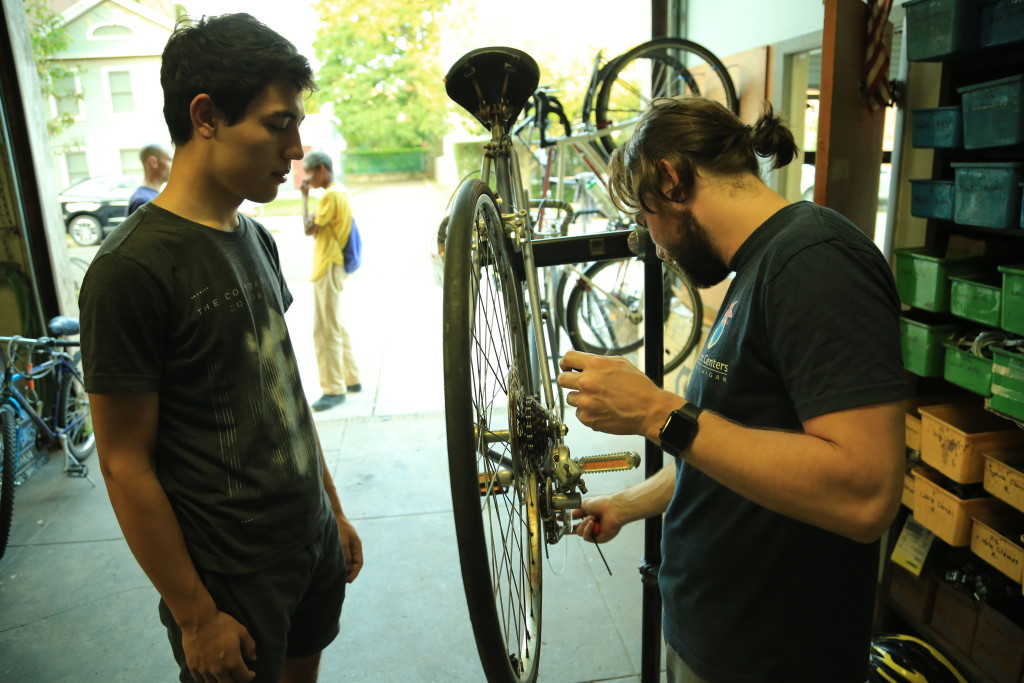 Repairing a bike at the Co-op. (Credit to William Reid)
